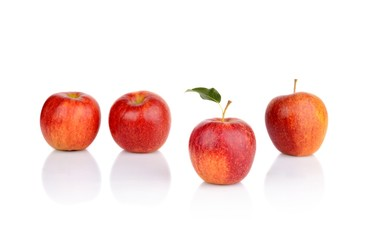 Apple which stands out from the crowd isolated
