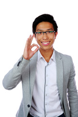 Happy asian man showing okay sign isolated on white background