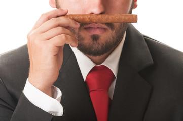 Business man smelling an original cuban cigar.