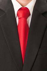 Black suit and red tie.