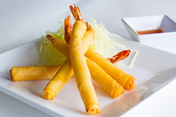 fried shrimp wrapped in egg roll skin