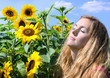 Young pretty woman relaxing in sunflower field :)