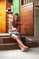 Cute girl reading book