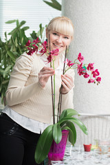 Happy woman with  orchid indoor