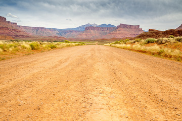 Dirt road through beautiful barren land
