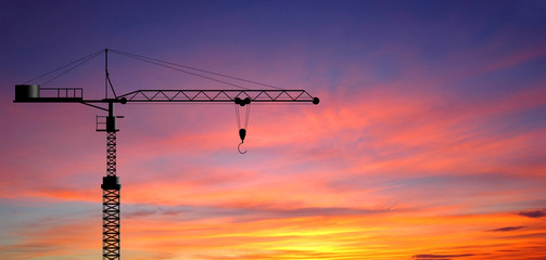 Crane working construction for business industrial and sunset ba