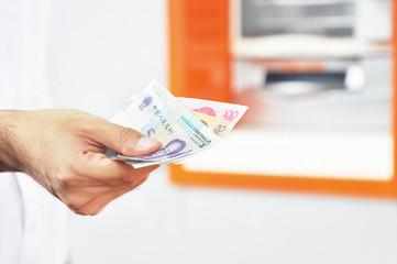 Hand holding money - Chinese renminbi yuan bills