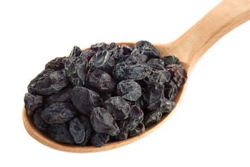 raisins fruit in spoon on white