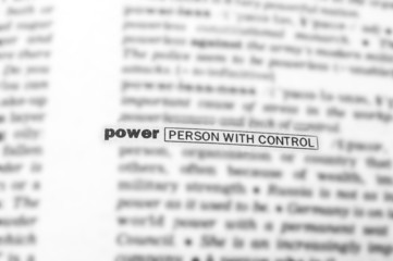 Blurred text in dictionary with focus on POWER.