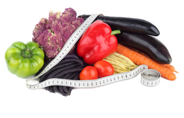 Diet food. Vegetables and measuring tape on a white background.