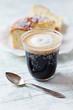 Glass of Espresso Macchiato and Cake on a Plate