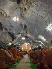 A lot of monks attend to pray together