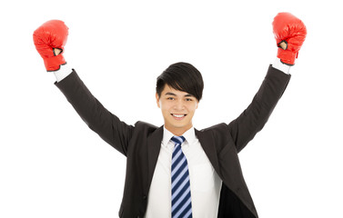 happy businessman raises hands with gloves