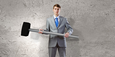 Businessman holding hammer