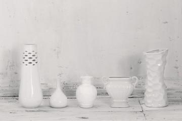 white vases on old grunge background
