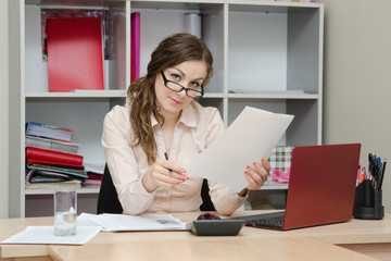 Business office girl reading a document