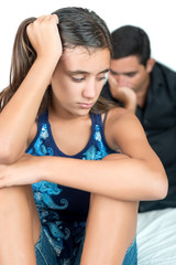 Troubled teenage girl with her worried father