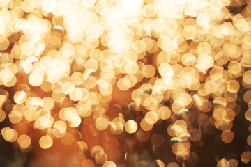 Glitter festive christmas lights background. light and gold