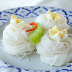 Fermented Rice Flour Noodles in classic plate with eggs