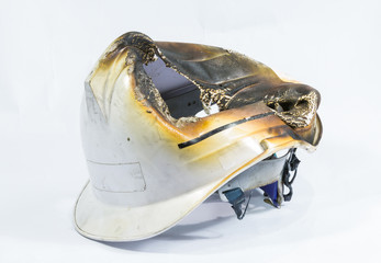 safety helmet on white background. damage by heat and fire