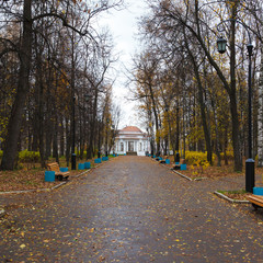Autumn alley with lanterns and rotunda