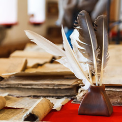 feathers and inkpot