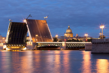 Bridge over Neva river in St.Petersburg at evening