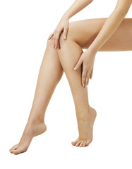 Legs woman applying masage spa cream. Isolated white background.