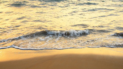 The waves and the sand on the beach