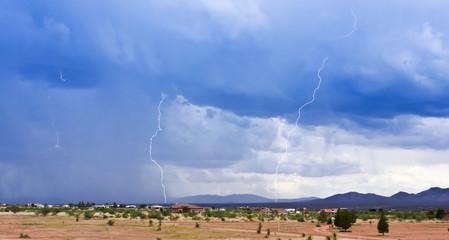 A Pair of Lightning Strikes Above a Rural Neighborhood