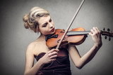 beautiful woman who is playing the violin