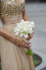 Bride hold her calla wedding bouquet