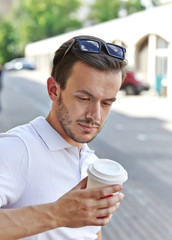 young man with cup of coffee