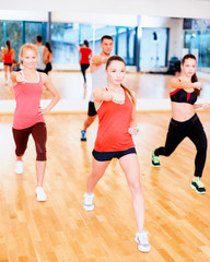 group of concentrated people exercising in the gym