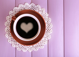 Cup of strong coffee on color wooden background