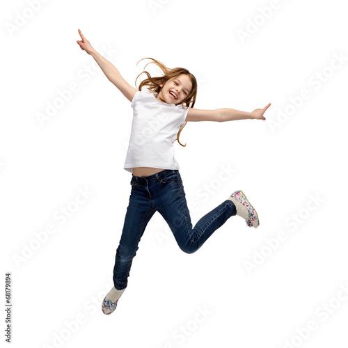 smiling little girl jumping - 68179894