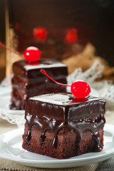 Chocolate coated fudge with candied cherry