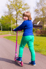 Young girl with pink step looking back
