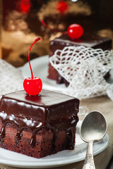 Chocolate coated fudge with candied cherry and lace