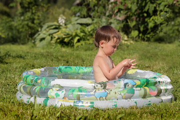 child playing in the pool outdoors