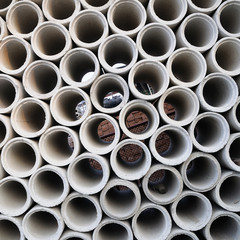 Concrete pipes stacking, background and pattern