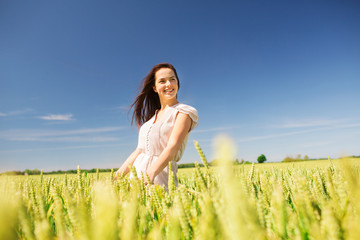 smiling young woman on cereal field