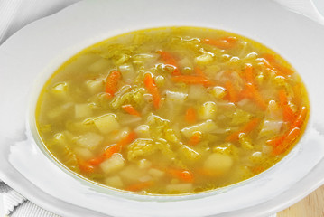 Savoy cabbage soup served in a white plate