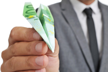 businessman with a paper plane made with a 100 euro bankno