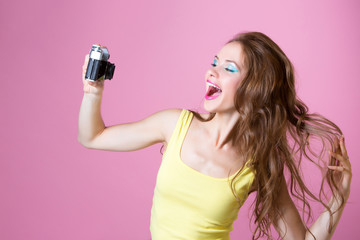 girl posing in front of the camera and doing a self