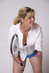 Squash player serving