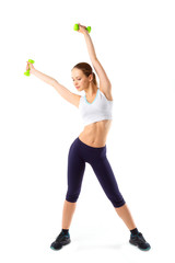 Full body of cheerful woman in fitness wear exercising with dumb