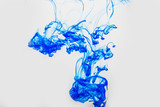 abstract blue paint drops in water