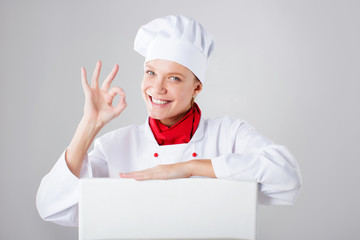 Chef Sign. Woman cook looking over paper sign billboard. Surpris