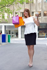 Happy lady shopping downtown